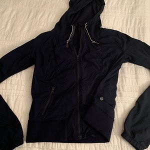 Navy hooded Lululemon zip up jacket.